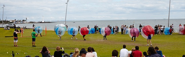 group enjoying a bubble soccer team building activity
