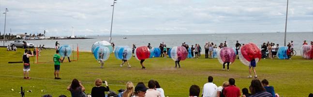 group enjoying a bubble soccer team building activity
