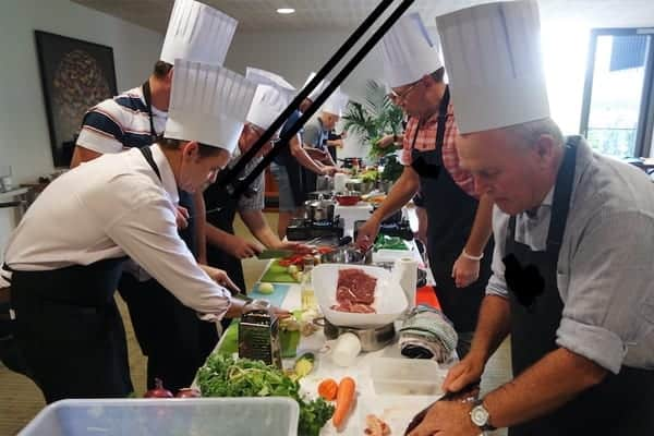 Cooking for Charity Team Building Activity - teams preparing food to donate