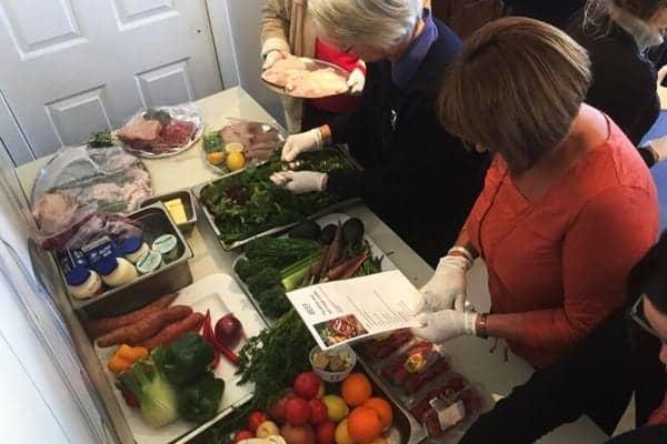 teams preparing food in Lets get cooking team building activities